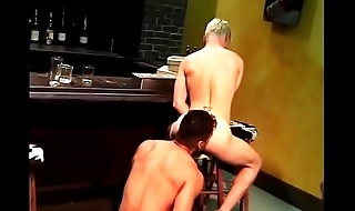 Blonde boy gets his tight ass fucked hard by a manly dude in a bar