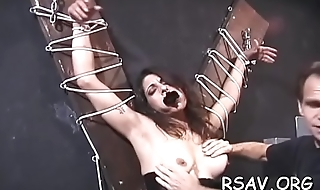 Bounded man endures pain as domina goes full bdsm on him